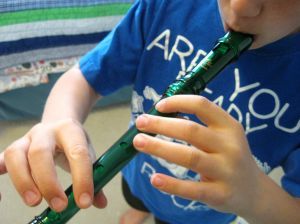 My son playing a recorder