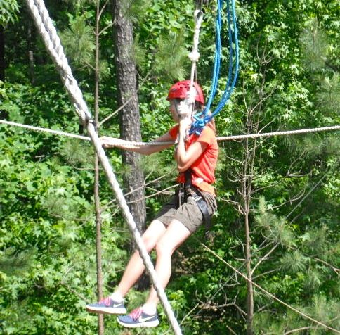This little zipline wasn't so bad but getting to the pole at the other end and connecting my hooks to a safety wire caused great panic. Thankfully someone did that job for me. I hugged the pole.